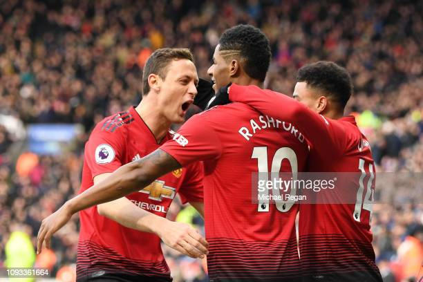 Marcus Rashford of Manchester United celebrates with teammates after scoring his team's first goal during the Premier League match between Leicester...