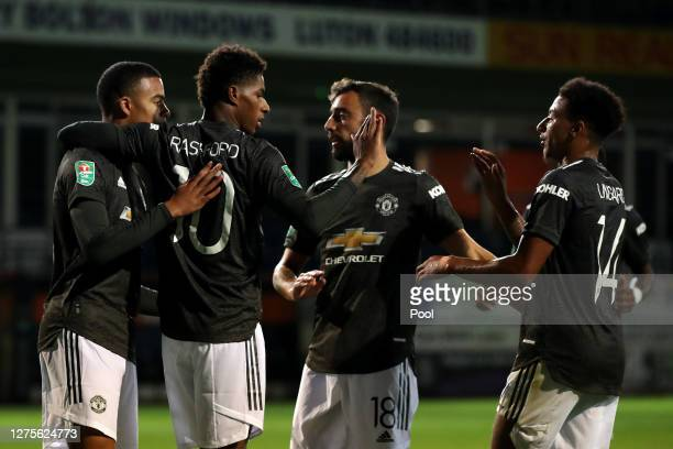 Marcus Rashford of Manchester United celebrates with teammates after scoring his sides second goal during the Carabao Cup Third Round match between...