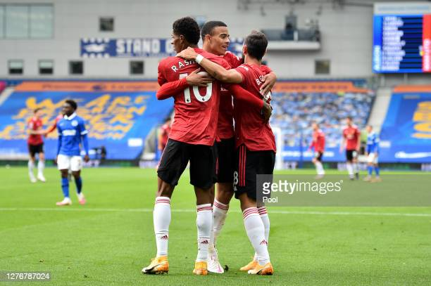 Marcus Rashford of Manchester United celebrates with teammates Bruno Fernandes and Mason Greenwood after scoring his team's second goal during the...