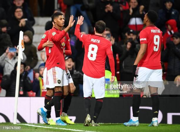 Marcus Rashford of Manchester United celebrates with teammates Mason Greenwood , Juan Mata and Anthony Martial of Manchester United after scoring his...