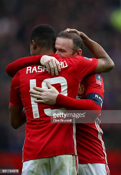 Marcus Rashford of Manchester United celebrates with Wayne Rooney of Manchester United after scoring his first and his sides third goal during the...