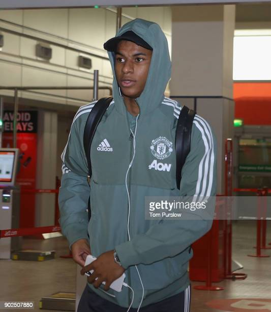 Marcus Rashford of Manchester United checks in ahead of a flight to Dubai for a warmweather training camp at Manchester Airport on January 8 2018 in...