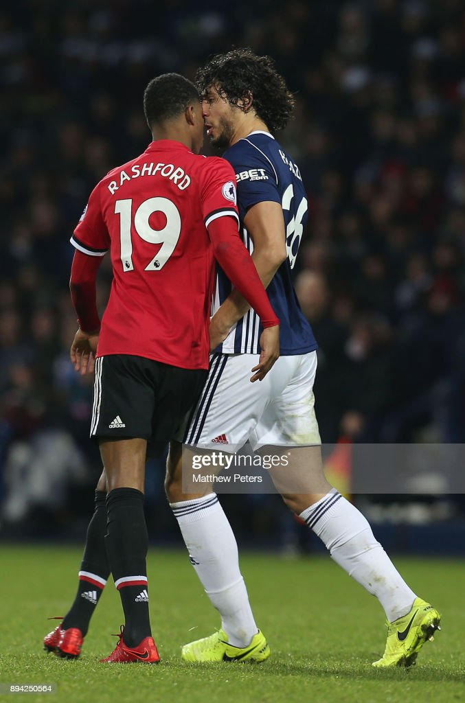 Marcus Rashford of Manchester United clashes with Ahmed Hegazi of West Bromwich Albion during the Premier League match between West Bromwich Albion and Manchester United at The Hawthorns on December 17, 2017 in West Bromwich, England.