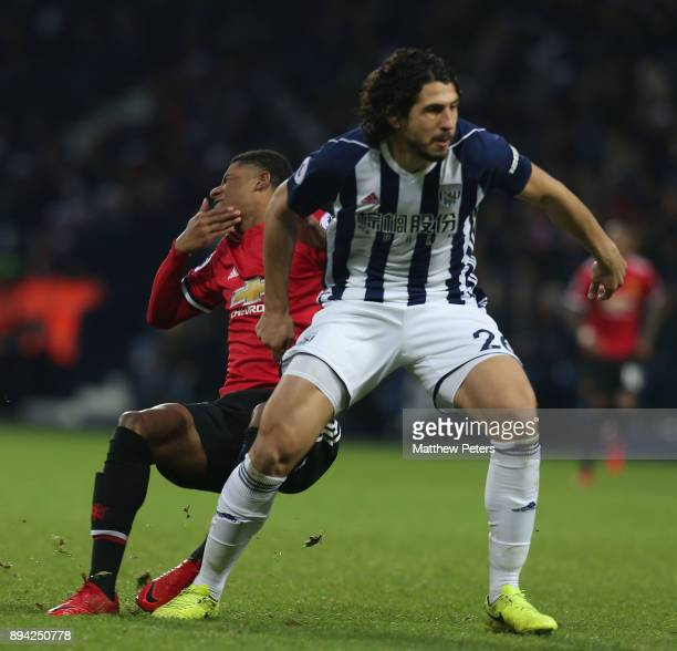Marcus Rashford of Manchester United clashes with Ahmed Hegazi of West Bromwich Albion during the Premier League match between West Bromwich Albion...