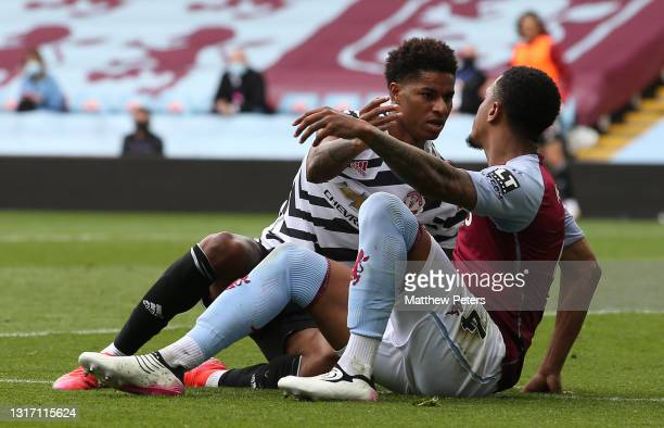 Marcus Rashford of Manchester United clashes with Ezri Konsa of Aston Villa during the Premier League match between Aston Villa and Manchester United...