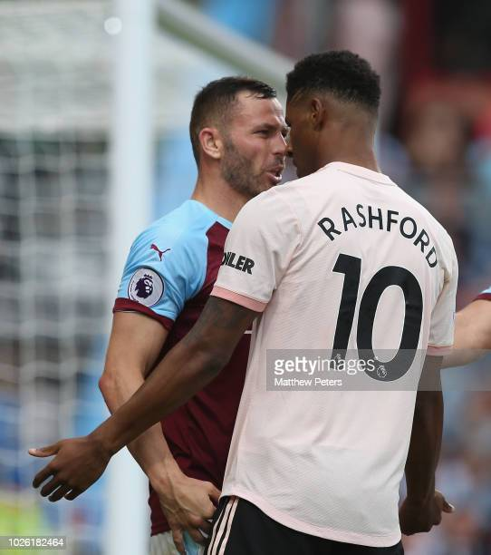 Marcus Rashford of Manchester United clashes with Phil Bardsley of Burnley during the Premier League match between Burnley FC and Manchester United...