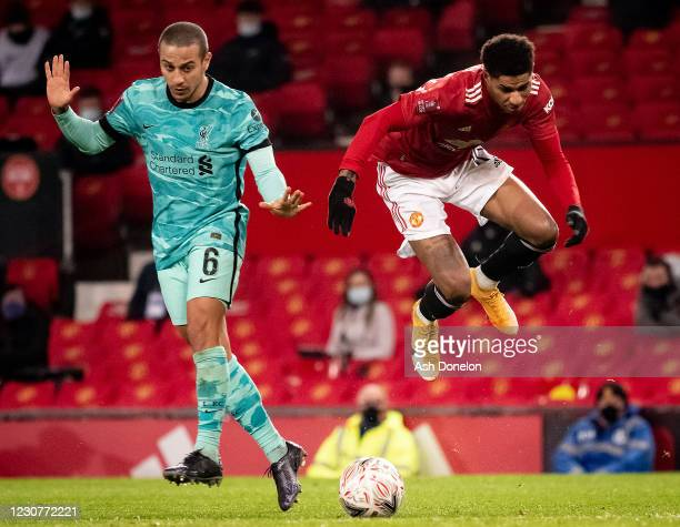 Marcus Rashford of Manchester United competes with Thiago Alcantara of Liverpool during the Emirates FA Cup Fourth Round match between Manchester...