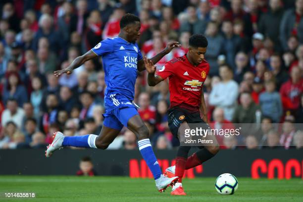 Marcus Rashford of Manchester United competes with Wilfried Ndidi of Leicester City during the Premier League match between Manchester United and...
