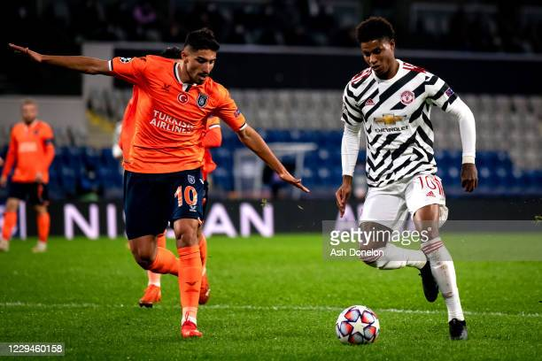 Marcus Rashford of Manchester United competes with with Berkay Ozcan of Istanbul Basaksehir during the UEFA Champions League Group H match between...