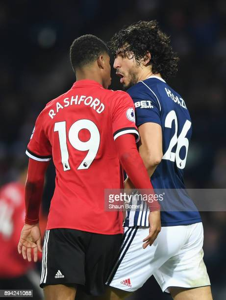 Marcus Rashford of Manchester United confronts Ahmed ElSayed Hegazi of West Bromwich Albion during the Premier League match between West Bromwich...