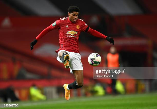 Marcus Rashford of Manchester United controls the ball during the Carabao Cup Semi Final match between Manchester United and Manchester City at Old...