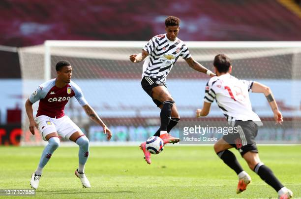 Marcus Rashford of Manchester United controls the ball whilst under pressure from Ezri Konsa of Aston Villa during the Premier League match between...