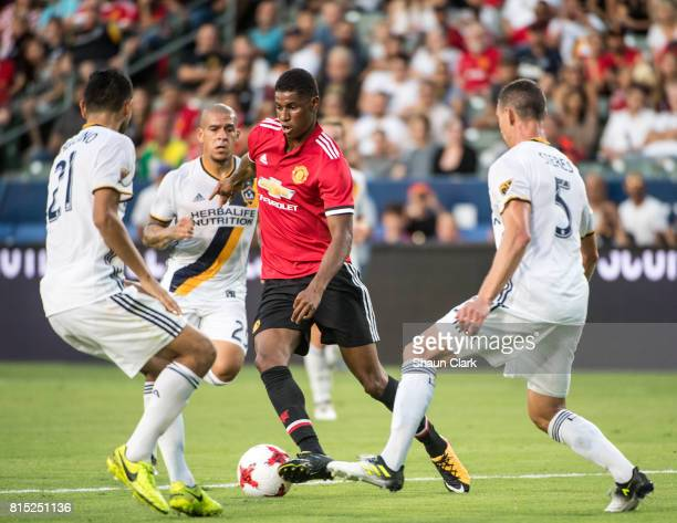 Marcus Rashford of Manchester United dribbles through the Galaxy defense during the Los Angeles Galaxy's friendly match against Manchester United at...
