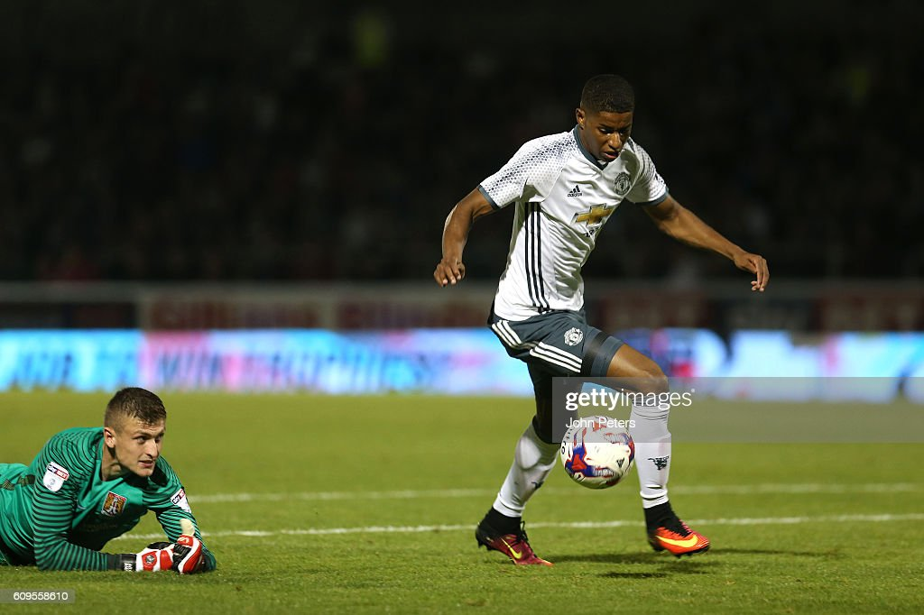Marcus Rashford of Manchester United gets clear to score his team's third goal during the EFL Cup Third Round match between Northampton Town and Manchester United at Sixfields on September 21, 2016 in Northampton, England.