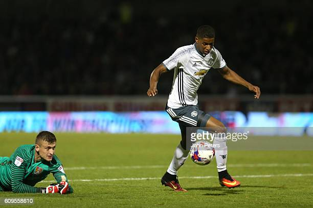 Marcus Rashford of Manchester United gets clear to score his team's third goal during the EFL Cup Third Round match between Northampton Town and...