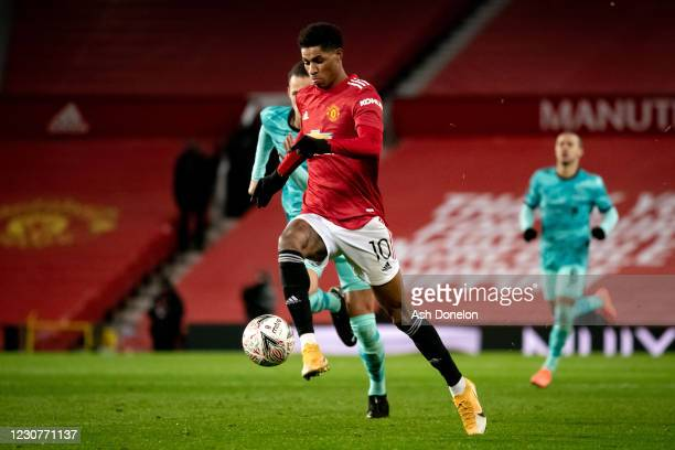 Marcus Rashford of Manchester United goes clear to score a goal to make the score 2-1 during the Emirates FA Cup Fourth Round match between...