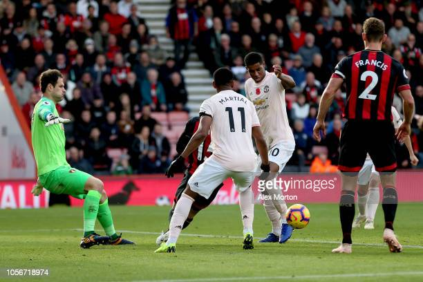 Marcus Rashford of Manchester United goes through to score his sides first goal during the Premier League match between AFC Bournemouth and...