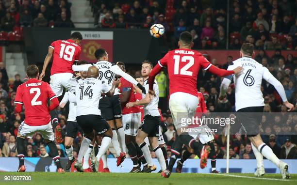 Marcus Rashford of Manchester United has a header on goal during the Emirates FA Cup Third Round match between Manchester United and Derby County at...