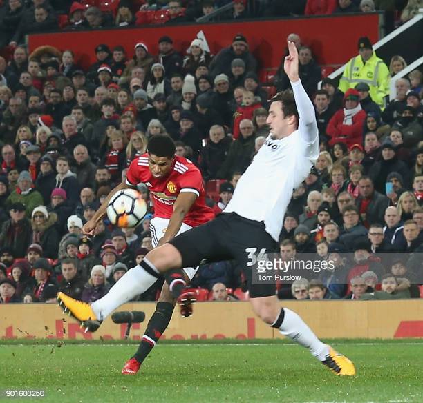 Marcus Rashford of Manchester United has a shot on goal during the Emirates FA Cup Third Round match between Manchester United and Derby County at...