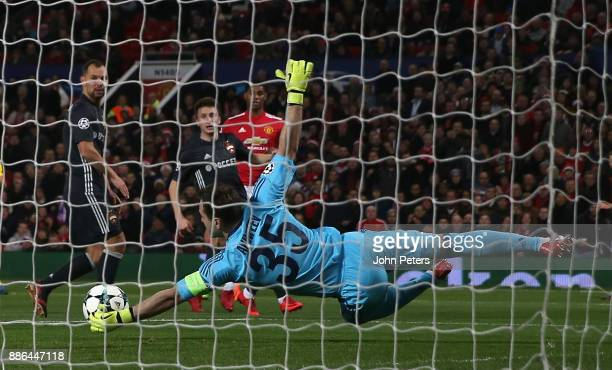 Marcus Rashford of Manchester United has a shot saved by Igor Akinfeev of CSKA Moscow during the UEFA Champions League group A match between...