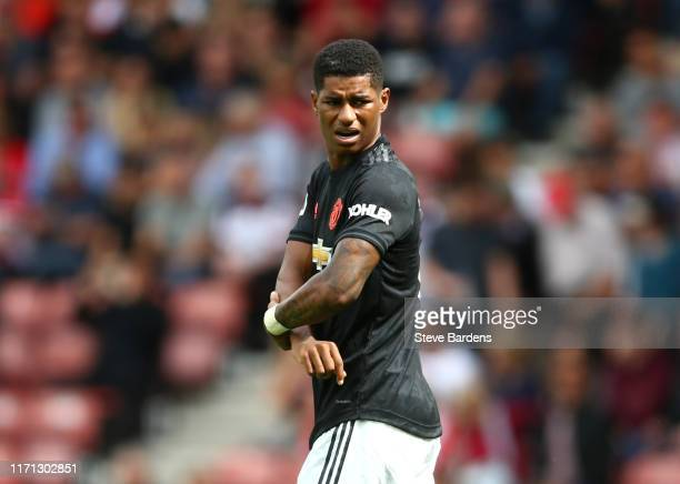 Marcus Rashford of Manchester United holds his arm during the Premier League match between Southampton FC and Manchester United at St Mary's Stadium...