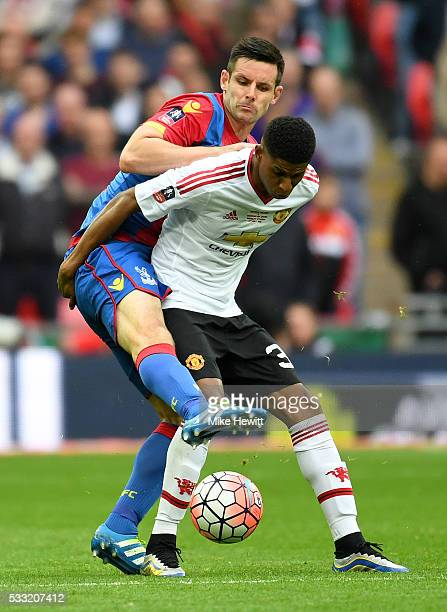 Marcus Rashford of Manchester United holds off Scott Dann of Crystal Palace during The Emirates FA Cup Final match between Manchester United and...