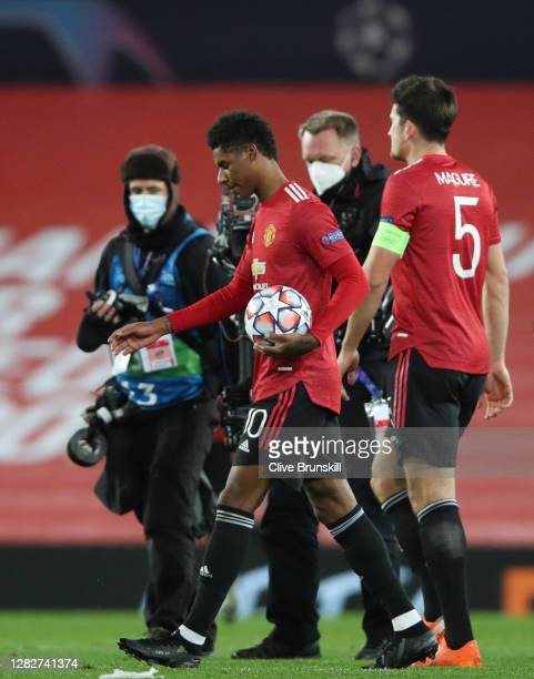 Marcus Rashford of Manchester United holds the match ball after scoring a hat-trick following the UEFA Champions League Group H stage match between...