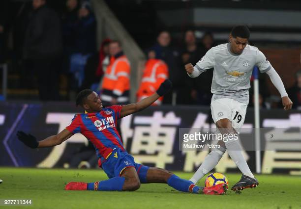Marcus Rashford of Manchester United in action with Aaron WanBissaka of Crystal Palace during the Premier League match between Crystal Palace and...