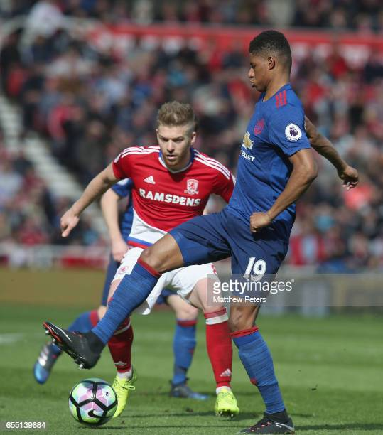 Marcus Rashford of Manchester United in action with Adam Clayton of Middlesbrough during the Premier League match between Middlesbrough and...