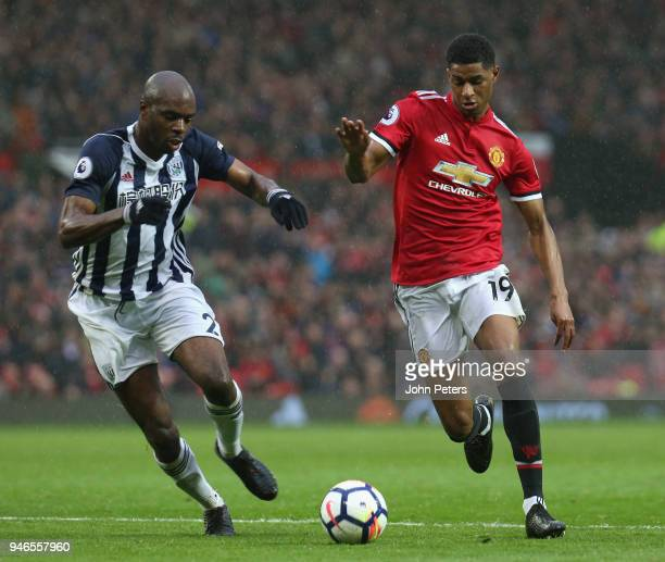 Marcus Rashford of Manchester United in action with Allan Nyom of West Bromwich Albion during the Premier League match between Manchester United and...