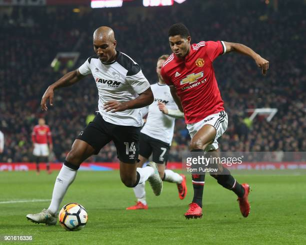 Marcus Rashford of Manchester United in action with Andre Wisdom of Derby County during the Emirates FA Cup Third Round match between Manchester...