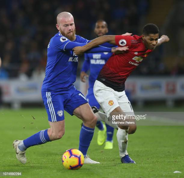 Marcus Rashford of Manchester United in action with Aron Gunnarsson of Cardiff City during the Premier League match between Cardiff City and...