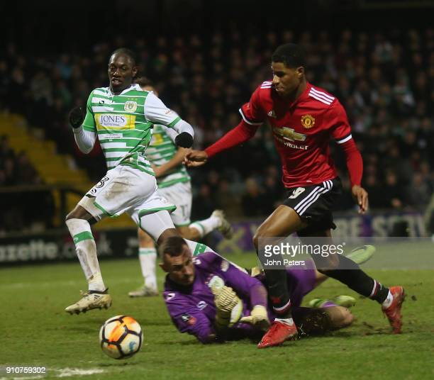 Marcus Rashford of Manchester United in action with Artur Krysiak of Yeovil Town during the Emirates FA Cup Fourth Round match between Yeovil Town...