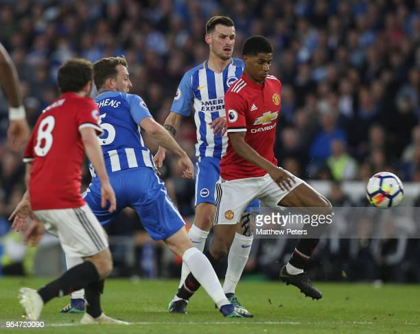 Marcus Rashford of Manchester United in action with Dale Stephens of Brighton and Hove Albion during the Premier League match between Brighton and...
