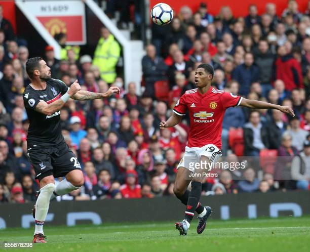 Marcus Rashford of Manchester United in action with Damien Delaney of Crystal Palace during the Premier League match between Manchester United and...