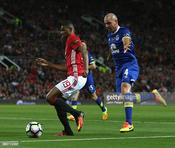 Marcus Rashford of Manchester United in action with Darron Gibson of Everton during the Wayne Rooney Testimonial match between Manchester United and...