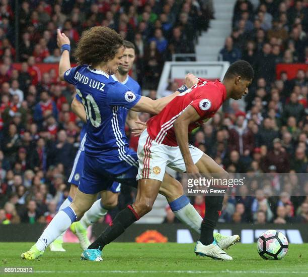 Marcus Rashford of Manchester United in action with David Luiz of Chelsea during the Premier League match between Manchester United and Chelsea at...