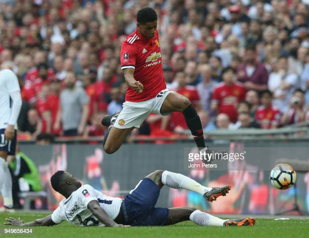 Marcus Rashford of Manchester United in action with Davinson Sanchez of Tottenham Hotspur during the Emirates FA Cup semifinal match between...