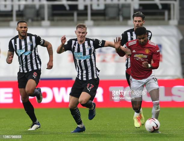 Marcus Rashford of Manchester United in action with Emil Krafth of Newcastle United during the Premier League match between Newcastle United and...