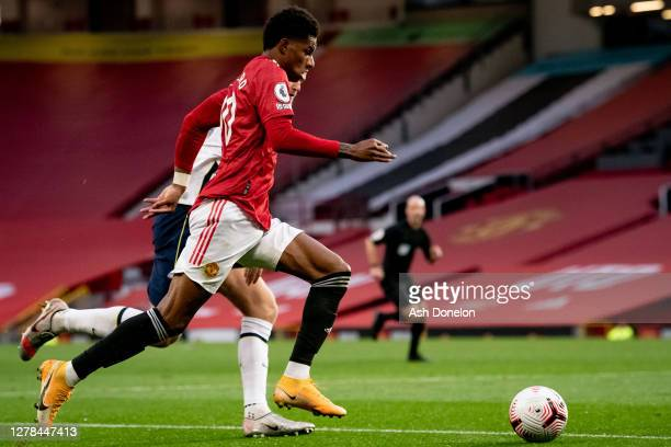 Marcus Rashford of Manchester United in action with Eric Dier of Tottenham Hotspur during the Premier League match between Manchester United and...