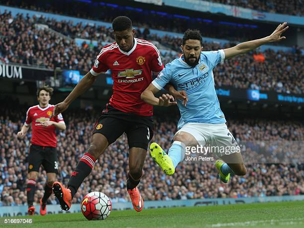 Marcus Rashford of Manchester United in action with Gael Clichy of Manchester City during the Barclays Premier League match between Manchester City...