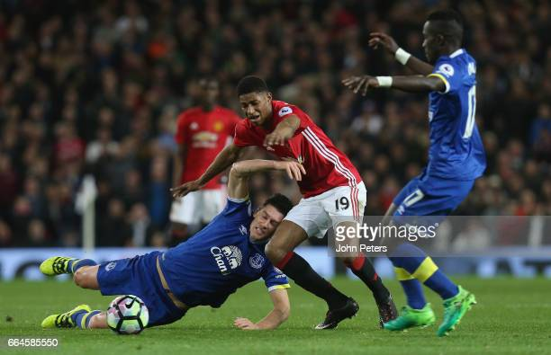 Marcus Rashford of Manchester United in action with Gareth Barry of Everton during the Premier League match between Manchester United and Everton at...
