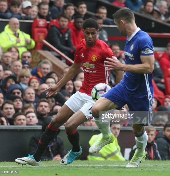 Marcus Rashford of Manchester United in action with Gary Cahill of Chelsea during the Premier League match between Manchester United and Chelsea at...