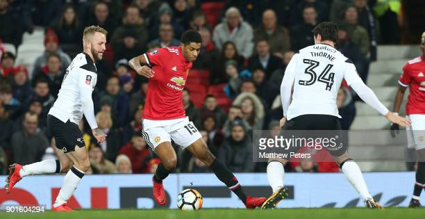 Marcus Rashford of Manchester United in action with George Thorne of Derby County during the Emirates FA Cup Third Round match between Manchester...