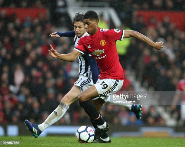 Marcus Rashford of Manchester United in action with Grzegorz Krychowiak of West Bromwich Albion during the Premier League match between Manchester...