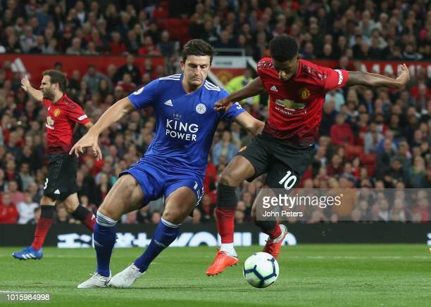 Marcus Rashford of Manchester United in action with Harry Maguire of Leicester City during the Premier League match between Manchester United and...