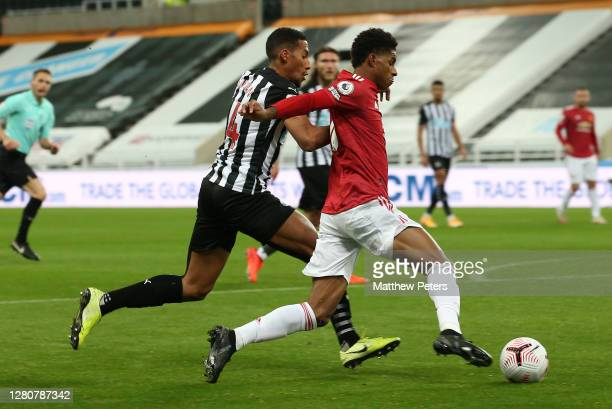 Marcus Rashford of Manchester United in action with Isaac Hayden of Newcastle United during the Premier League match between Newcastle United and...