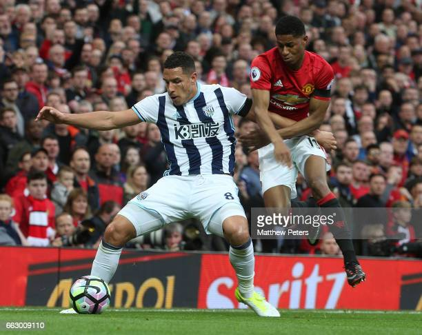 Marcus Rashford of Manchester United in action with Jake Livermore of West Bromwich Albion during the Premier League match between Manchester United...