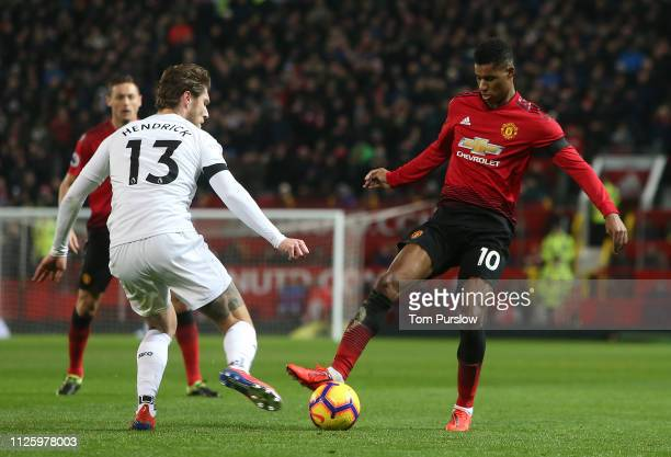 Marcus Rashford of Manchester United in action with Jeff Hendrick of Burnley during the Premier League match between Manchester United and Burnley FC...