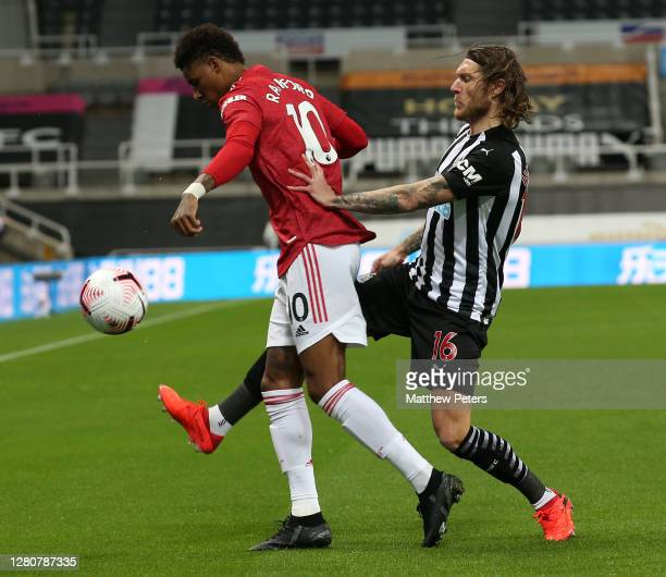 Marcus Rashford of Manchester United in action with Jeff Hendrick of Newcastle United during the Premier League match between Newcastle United and...